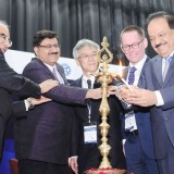 """The Union Minister for Science & Technology, Earth Sciences and Environment, Forest & Climate Change, Dr. Harsh Vardhan lighting the lamp to inaugurate the symposium on """"Indian Strategy for Quality Infrastructure"""", during the 33rd Asia Pacific Metrology Program General Assembly Meeting, in New Delhi on November 28, 2017."""